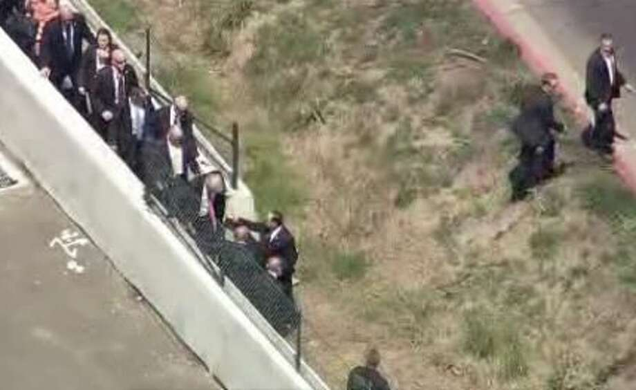 Donald Trump jumps down from freeway barriers to enter the California GOP convention through the back door at the Hyatt Regency in Burlingame on Friday, Aug. 29, 2016. Photo: KPIX