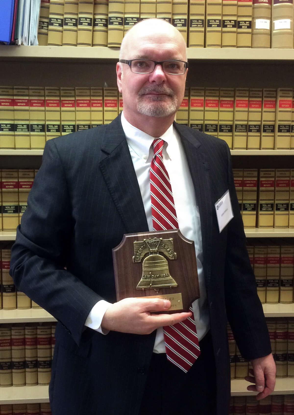 State's Attorney John Smriga received the Greater Bridgeport Bar Association's Liberty Bell Award Friday.