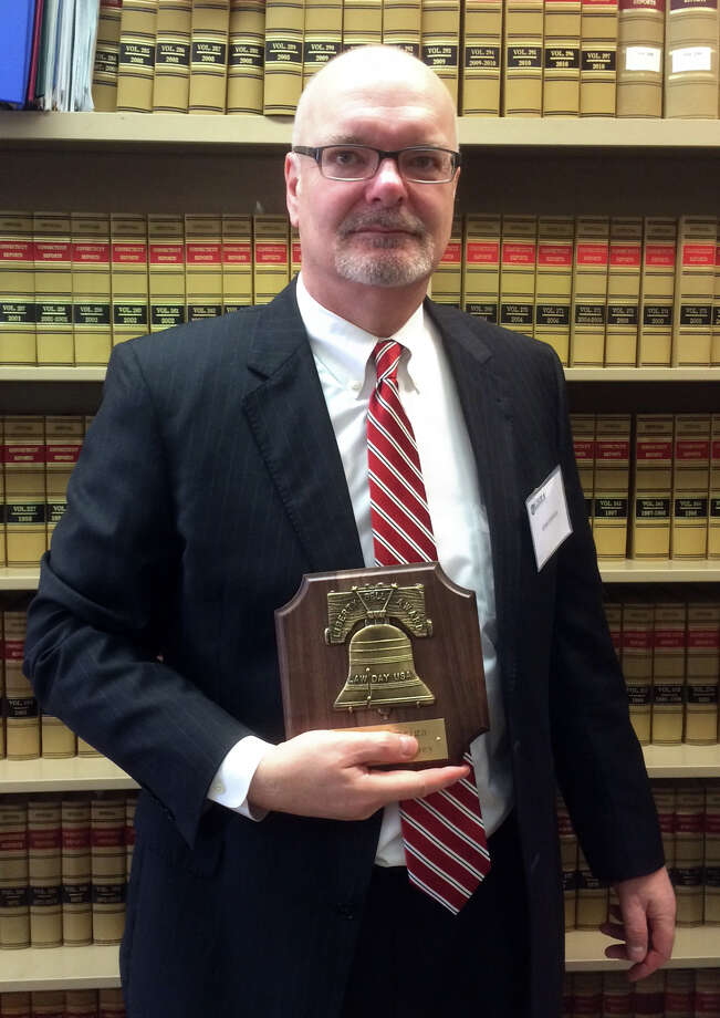 State's Attorney John Smriga received the Greater Bridgeport Bar Association's Liberty Bell Award Friday. Photo: Dan Tepfer / Hearst Connecticut Media / Connecticut Post