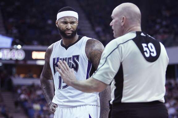 Sacramento Kings center DeMarcus Cousins chats with official Gary Zielinski during the second half of an NBA basketball game against the Dallas Mavericks in Sacramento, Calif., Sunday, March. 27, 2016. The Kings won 133-111. (AP Photo/Steve Yeater)