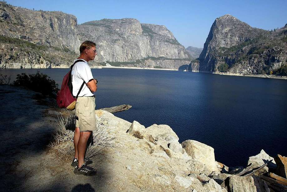 Hetch Hetchy Reservoir in Yosemite National Park provides San Francisco with power and its drinking water. The water project's Mocassin power station was evacuated Friday because of the nearby Moc Fire, which broke out the previous day. The SFPUC says the the Northern California wildfires have neither affected water quality nor the system's infrastructure. Photo: MONICA ALMEIDA, NYT