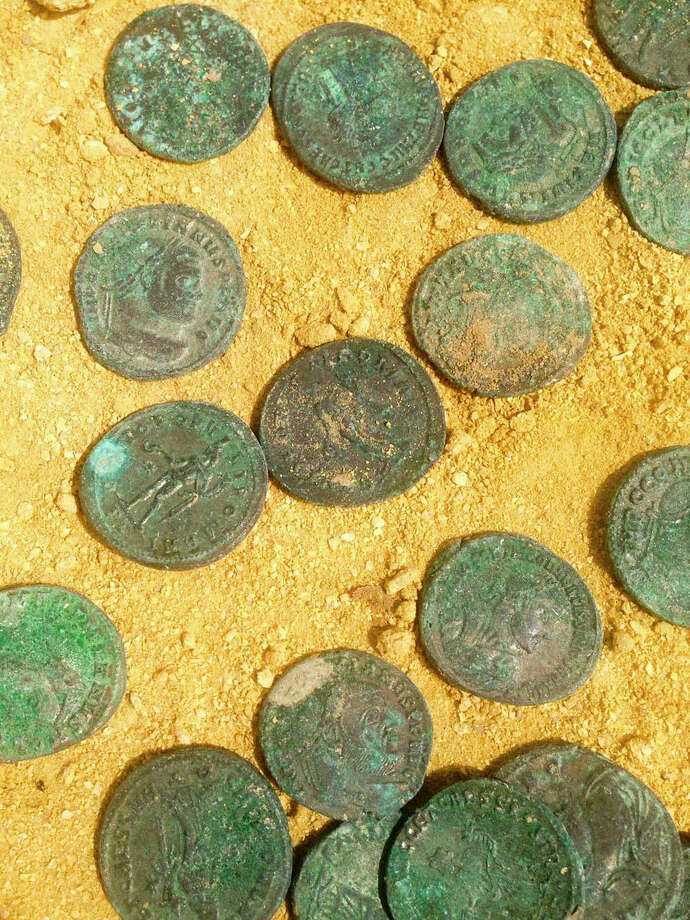 Construction workers unearthed a trove of bronze and silver Roman coins in Spain. Photo: HOGP / CITY COUNCIL OF TOMARES