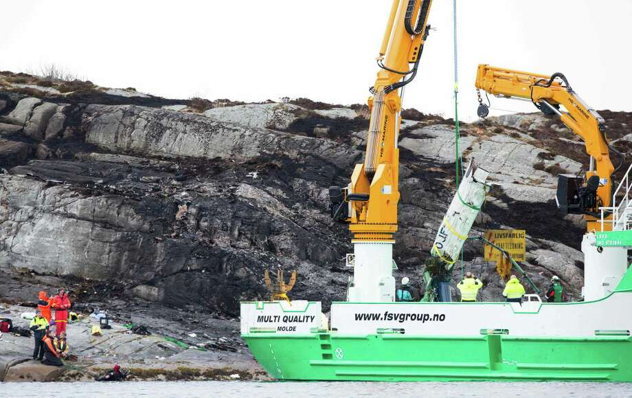 A rescue vessel lifts pieces of the helicopter that crashed off Norway's coast with 13 people who were returning to land from Statoil's Gullfaks B oil platform. The crash's cause was unclear, but the company grounded all similar helicopters.   Photo: TORSTEIN BOE, Stringer / AFP