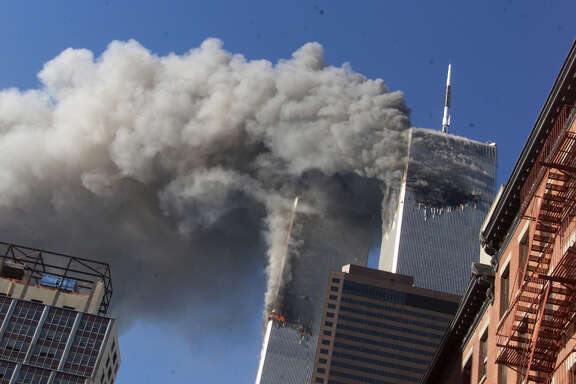 Smoke rising from the burning twin towers of the World Trade Center on Sept. 11, 2001, after hijacked planes crashed into the towers, in New York City. A bill in Congress would allow family members of those who died in the attacks to sue Saudi Arabia for its alleged role. Its role is a matter of dispute.