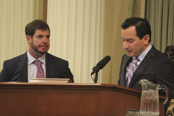 California Assembly Speaker Anthony Rendon, right, D-Paramount, introduces newly elected Assemblyman Joaquin Arambula, left, D-Kingsburg, on Thursday, April 14, 2016, in Sacramento, California. Arambula won a special election April 5 to replace former Assemblyman Henry Perea, who resigned to work for the pharmaceutical industry. (AP Photo/Jonathan J. Cooper)