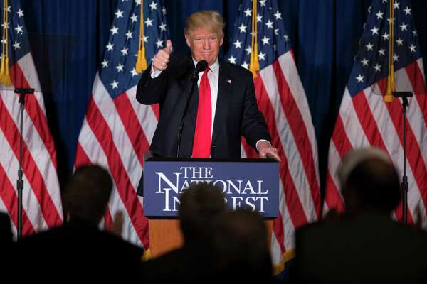 Republican presidential candidate Donald Trump gives a thumbs up after a foreign policy speech at the Mayflower Hotel in Washington, Wednesday. He says America First and means retreat but for different reasons than liberals.