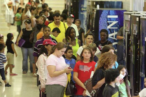 Hundreds stand in line during the Montgomery County Hospital District's 15th annual Shots Across Texas free immunization event in 2010 in Conroe, Texas. Over 800 children received vaccinations at the event, but today too many Texan parents are opting their children out of vaccinations. This is dangerous.