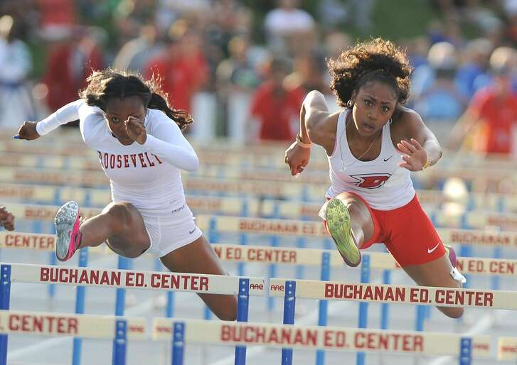Roosevelt-Eastvale senior and national leader Jasmyne Graham, left, and Dublin junior Becca McGlaston, right, compete in finals of the 100-meter hurdles, during the CIF State Championships in Clovis, California, on Saturday, June 6, 2015. Graham won with a time of 13.17, compared to McGlaston's time of 13.18 seconds.