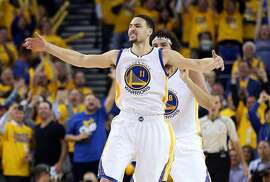 OAKLAND, CA - APRIL 27:  Klay Thompson #11 of the Golden State Warriors and Anderson Varejao #18 of the Golden State Warriors celebrate after Thompson made a three-point basket against the Houston Rockets in Game Five of the Western Conference Quarterfinals during the 2016 NBA Playoffs at ORACLE Arena on April 27, 2016 in Oakland, California. NOTE TO USER: User expressly acknowledges and agrees that, by downloading and or using this photograph, user is consenting to the terms and conditions of Getty Images License Agreement.  (Photo by Ezra Shaw/Getty Images)