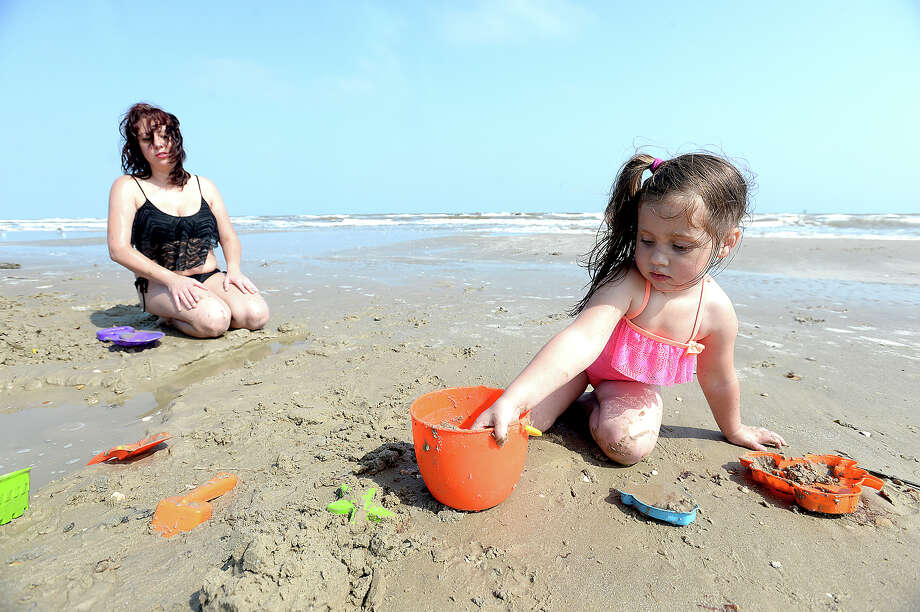 Jessica Wettstein and daughter Kayla Hershfield, 4, of Baytown build a moat while spending time at Crystal Beach in the Bolivar Peninsula Wednesday, April 27. The area continues to see new growth and development after being devastated by Hurricane Ike. Photo taken Wednesday, April 27, 2016 Kim Brent/The Enterprise Photo: Kim Brent / Beaumont Enterprise