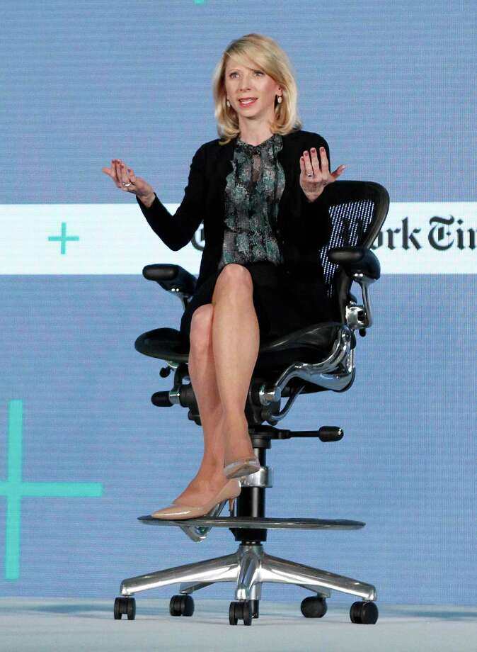 Click ahead to see demonstrations of poses that Amy Cuddy, Harvard Business School social psychologist and behaviorist said can boost your confidence and others that can make you look small. Photo: Kimberly White /Getty Images For New York Times / 2016 Getty Images
