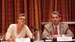 Travis County Judge Sarah Eckhardt (left) and San Antonio District 8 Councilman Ron Nirenberg listen to a speaker at a joint conference of San Antonio and Austin area governments regarding ozone pollution Friday.