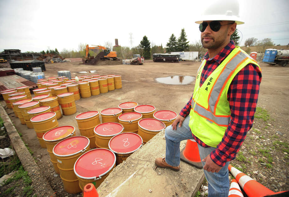 Dan Burgo, on-scene coordinator for the U.S. Environmental Protection Agency, stands overlooking the last remaining barrels of liquid waste to be removed from the site of a chemical fire that demolished a warehouse on Seaview Avenue in Bridgeport, Conn. on September 11, 2014. Photo: Brian A. Pounds / Hearst Connecticut Media / Connecticut Post