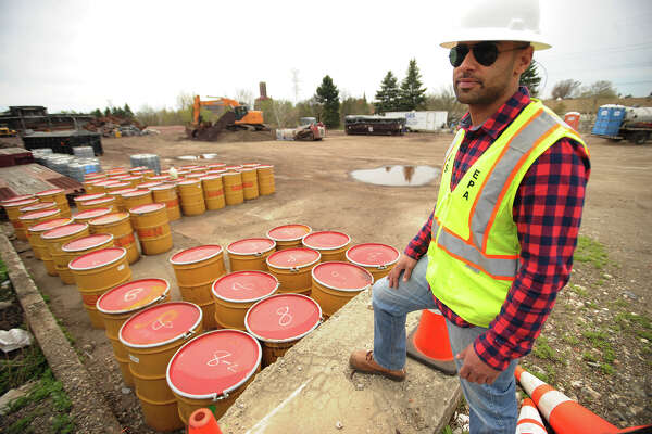 Dan Burgo, on-scene coordinator for the U.S. Environmental Protection Agency, stands overlooking the last remaining barrels of liquid waste to be removed from the site of a chemical fire that demolished a warehouse on Seaview Avenue in Bridgeport, Conn. on September 11, 2014.