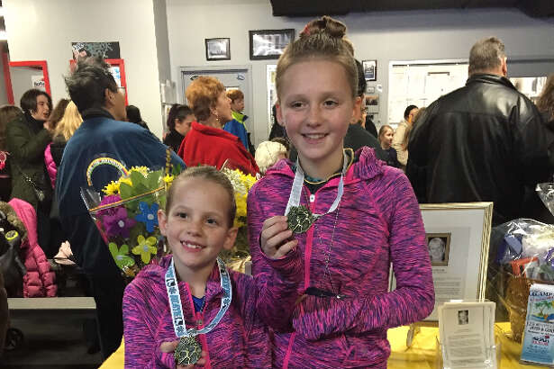 Ruby and Olivia Smith showcase their winning medals.