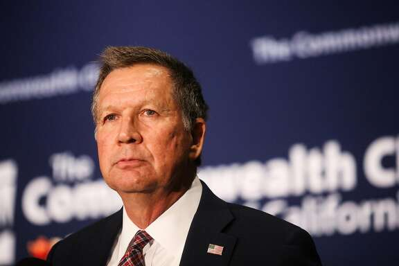 Republican Presidential candidate and Ohio Governor John Kasich listens as an audience member asks him a question, at a town hall meeting hosted by the Commonwealth Club, at the Parc Hotel, in San Francisco, California, on Friday, April 29, 2016.