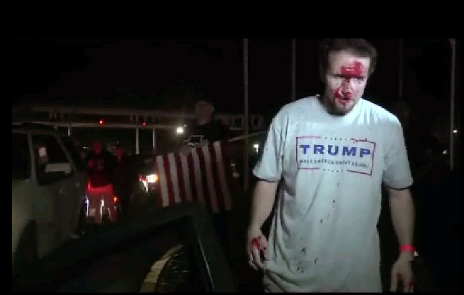 This still image taken from video shows a supporter of Republican presidential candidate Donald Trump after a protest on Thursday, April 28, 2016 in Costa Mesa, Calif.  Dozens of protesters were mostly peaceful Thursday as Trump gave his speech inside the Pacific Amphitheater. After the event, however, the demonstration grew rowdy late in the evening and spilled into the streets.  (APTN via AP Photo) Photo: TEL / (APTN via AP Photo)