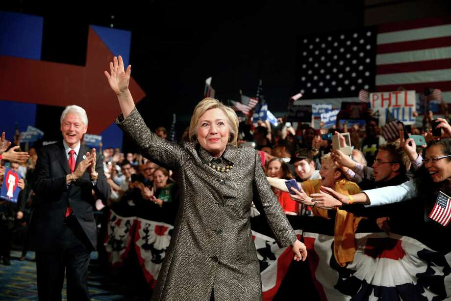 FILE - In this April 26, 2016 file photo, Democratic presidential candidate Hillary Clinton, accompanied by former President Bill Clinton walks to stage at her presidential primary election night rally in Philadelphia. (AP Photo/Matt Rourke, File) Photo: Matt Rourke, STF