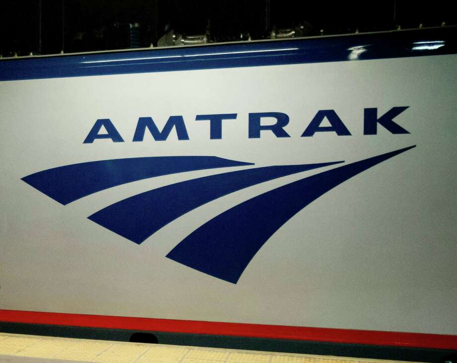 "FILE - In this Feb. 6, 2014 file photo, an Amtrak logo is seen on a train at 30th Street Station in Philadelphia. A federal appeals court has once again ruled that Congress can't give Amtrak power to impose rail standards on other private railroads. The U.S. Court of Appeals for the District of Columbia Circuit ruled Friday, April 29, 2016, it is unconstitutional to give a ""self-interested"" company regulatory power over competitors , even if Amtrak is a public-private hybrid. (AP Photo/Matt Rourke, File) ORG XMIT: WX102 Photo: Matt Rourke / A2014"