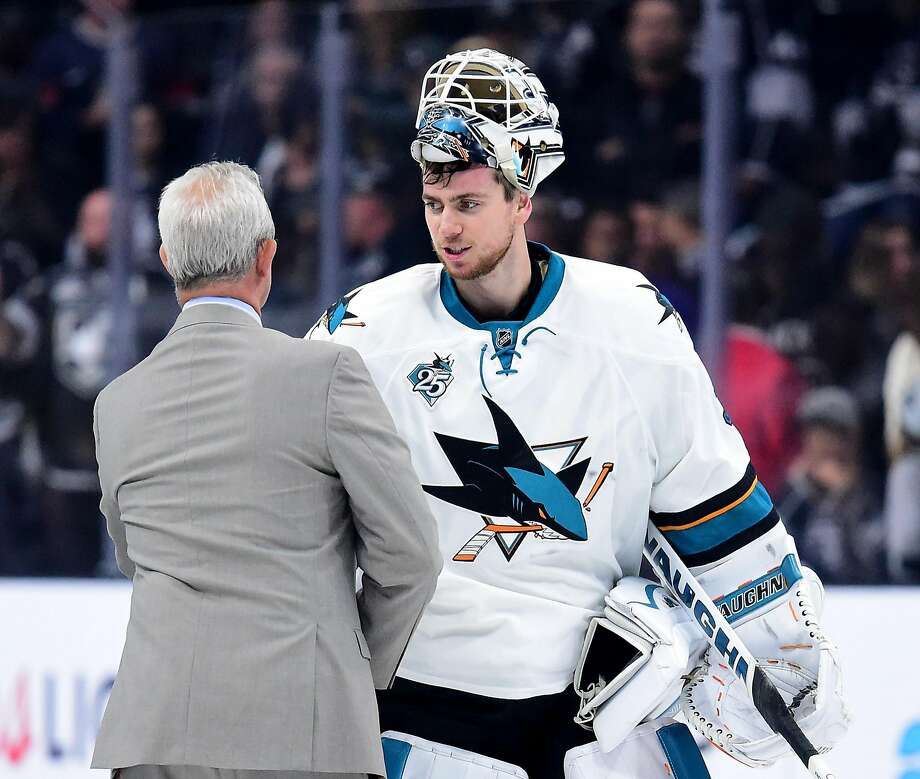 Martin Jones shakes hands with his old coach, Darryl Sutter of the Kings, after the Sharks eliminated Los Angeles. Photo: Harry How, Getty Images