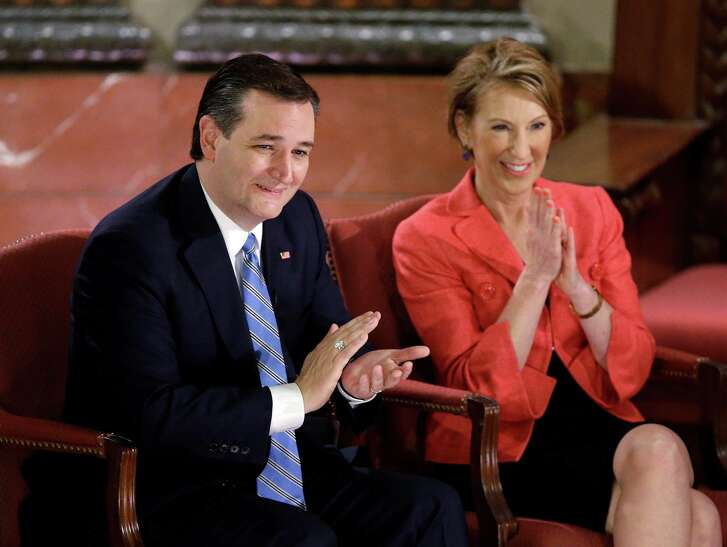 Republican presidential candidate, Sen. Ted Cruz, R-Texas, and vice-presidential candidate Carly Fiorina applaud during a question and answer session with Fox News Channel's Sean Hannity at The Indiana War Memorial Friday in Indianapolis. (AP Photo/Darron Cummings)