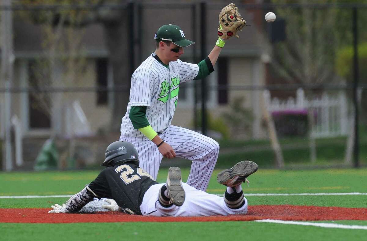 Alex Rauso (24) of the Trumbull Eagles dives safely into second during a game against the Norwalk Bears at Nathan Hale Middle School on April 29, 2016 in Norwalk, Connecticut.