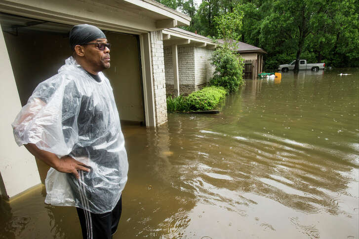 Craig Baldwin pauses outside his house while trying to clean up after the home was flooded in the Timber Lakes Timber Ridge subdivision on Monday, April 18 in The Woodlands. ( Brett Coomer / Houston Chronicle )