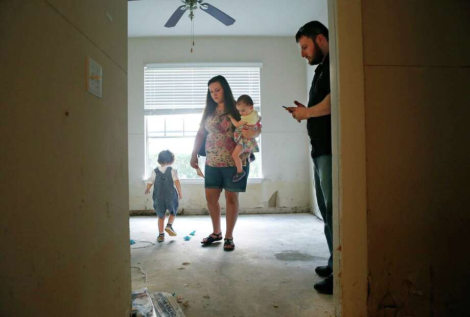 Richard and Ashley Freilich and their children Cole, 3, and Rebecca, 15 months, evacuated their apartment during last week's flood. When Richard returned to collect some of their possessions, cleaning crews had already thrown them out.  Photo: Mark Mulligan, Staff / © 2016 Houston Chronicle