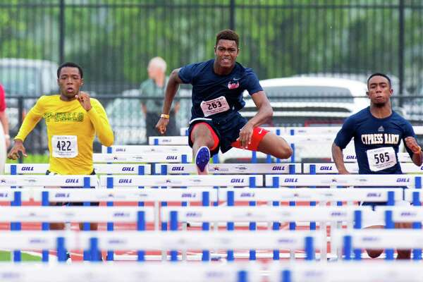 Abraham Adisepe of Alief Taylor leaping over hurdles during the 100 M Hurdles competition during UIL Region II 6-A Track & Field Championship at the Challenger Columbia Stadium, Friday, Apr. 29, 2016, in Houston. (Juan DeLeon / For the Houston Chronicle)
