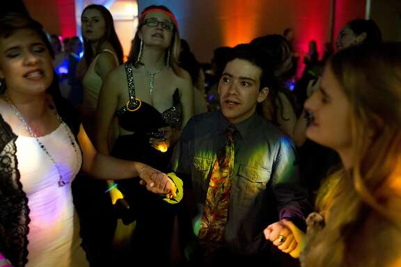 "Daniel Leader, 19, sings with friends at the UCSF Benioff Children�s Hospital prom on Friday, April 22, 2016 in San Francisco, Calif. Leader, who was born with spina bifida, says the prom at UCSF makes him feel at home. ""I feel like I can express myself and show myself,"" he says. ""I�m really joyful, talkative and social and that�s what I love to do."""
