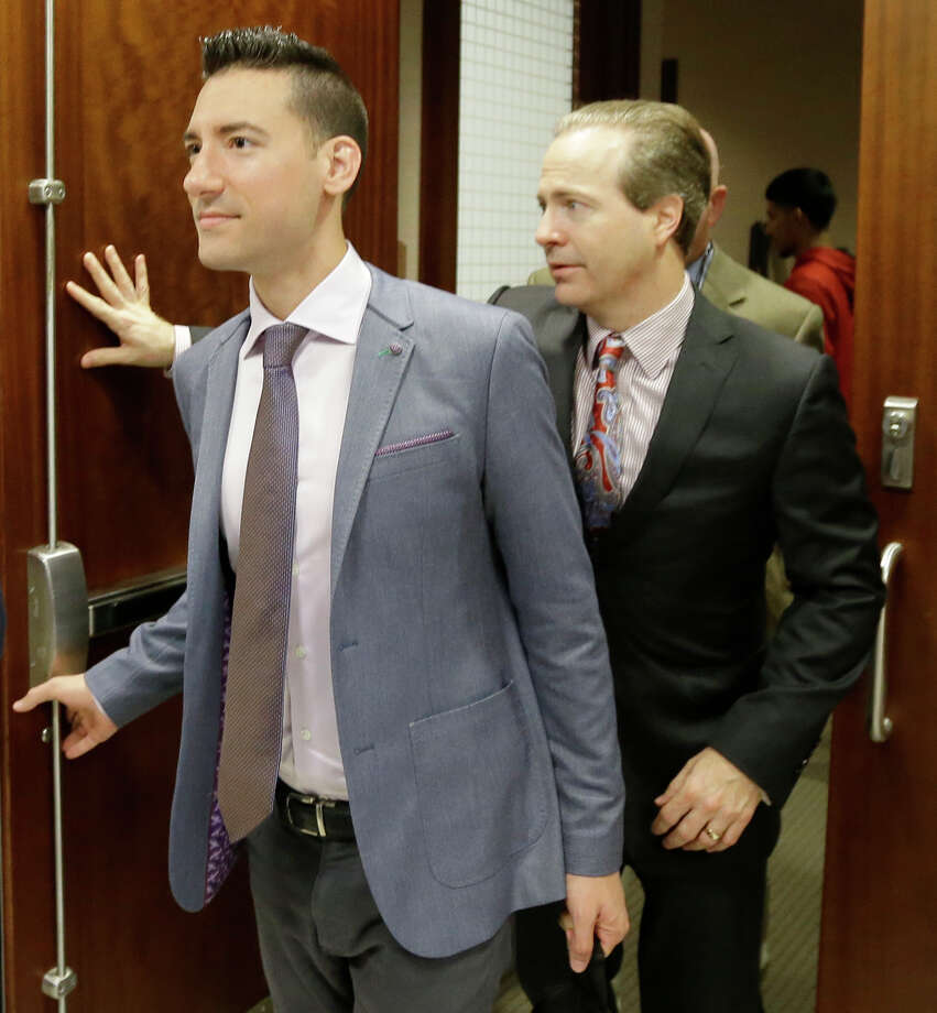 David Daleiden, left, with attorney Jared Woodfill, also declined the offer of low-level probation.  Photo: Melissa Phillip, Staff / © 2016 Houston Chronicle