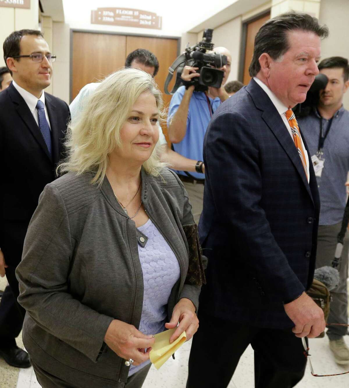Sandra Merritt leaves court with her attorney, Dan Cogdell, after rejecting the county's plea offer.