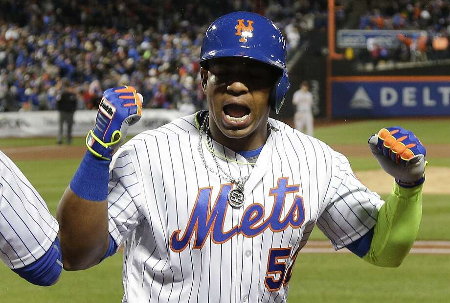 Yoenis Cespedes celebrates his third-inning grand slam, which gave the Mets a 12-run inning and Cespedes six RBIs in the inning. Photo: Julie Jacobson, Associated Press