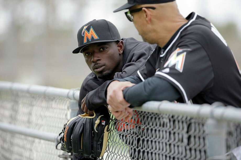 FILE - In this Feb. 19, 2016 file photo, Miami Marlins second baseman Dee Gordon leans against a fence during spring training baseball practice in Jupiter, Fla. Reigning NL batting champion Dee Gordon of the Miami Marlins says he unknowingly took the performance-enhancing drug that led to his 80-game suspension.  The startling announcement of the suspension by Major League Baseball came shortly after the Marlins' victory at Los Angeles on Thursday night, April 28, 2016. (AP Photo/Jeff Roberson, File) ORG XMIT: NY155 Photo: Jeff Roberson / Copyright 2016 The Associated Press. All rights reserved. This m