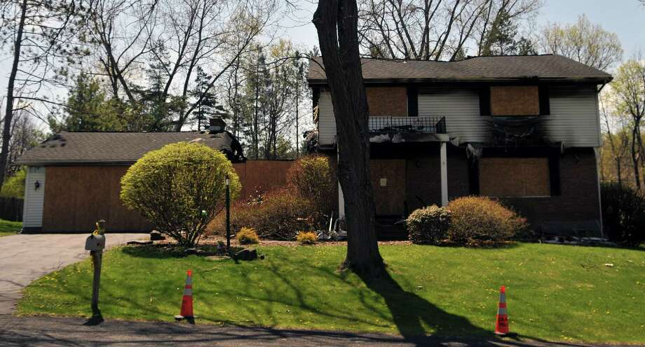 Israel Roman?s home still stands on Friday, April 29, 2016, months after he set it on fire and shot his wife, son, and himself in Colonie, N.Y. Neighbors complain about the eyesore and fire debris, but town officials said it could be years before the property gets cleaned up because Roman had no will and there are uncertainties about the insurance. (Brittany Gregory / Special to the Times Union) Photo: Brittany Gregory / 10036421A