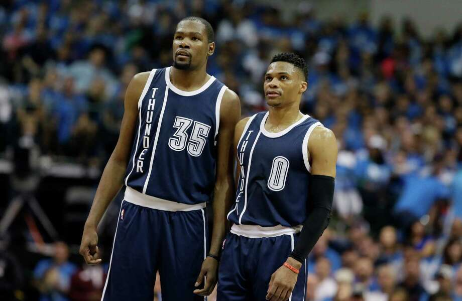 Forward Kevin Durant, left, led the Thunder in regular-season scoring with 28.2 points per game, while Russell Westbrook had 18 triple-doubles. Photo: LM Otero, STF / AP