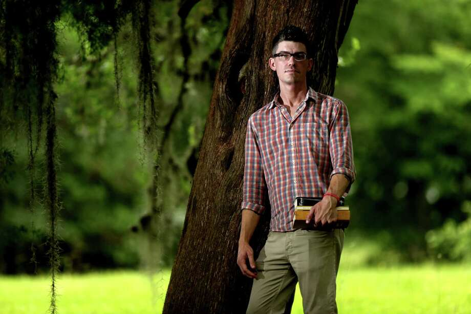 UH doctoral student Zachary Turpin unearthed a serial essay on healthy living by poet Walt Whitman. Photo: Gary Coronado, Staff / © 2015 Houston Chronicle