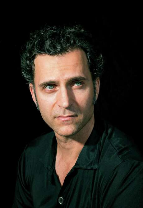 """Dweezil Zappa, one of four children of the late Frank Zappa, at home in Los Angeles, April 6, 2016. Thanks to an ongoing row with his siblings, he can no longer tour under the name Zappa Plays Zappa, and will instead pay tribute to his father's music as Dweezil Zappa Plays Frank Zappa. """"It doesn't exactly roll off the tongue, but this is being done under duress,"""" Dweezil noted. (Michael Lewis/The New York Times) Photo: MICHAEL LEWIS, STR / NYTNS"""