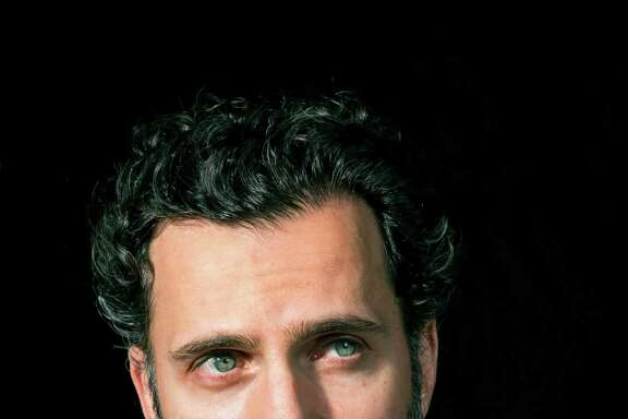 """Dweezil Zappa, one of four children of the late Frank Zappa, at home in Los Angeles, April 6, 2016. Thanks to an ongoing row with his siblings, he can no longer tour under the name Zappa Plays Zappa, and will instead pay tribute to his father's music as Dweezil Zappa Plays Frank Zappa. """"It doesn't exactly roll off the tongue, but this is being done under duress,"""" Dweezil noted. (Michael Lewis/The New York Times)"""