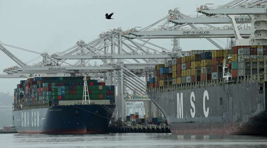Container ships are moored last month at the Port of Oakland in California.  Photo: Ben Margot, STF / Copyright 2016 The Associated Press. All rights reserved. This material may not be published, broadcast, rewritten or redistribu