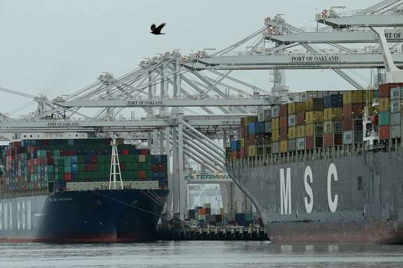 Container ships are moored last month at the Port of Oakland in California.