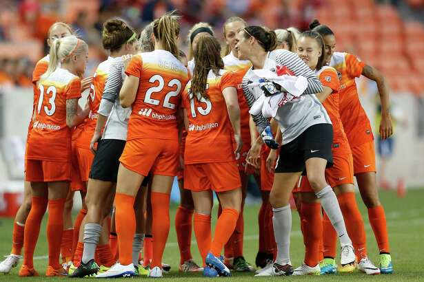 Houston Dash huddle before the start of the first half of a National Women's Soccer League game at BBVA Compass Stadium, Friday, April 29, 2016, in Houston.