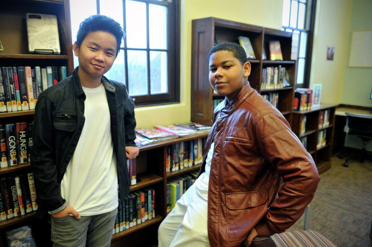 Songwriters Lee Reh, left, and Rahmene McDuffie pose for a photo at the Albany Public Library John Howe Branch on Monday, Jan. 25, 2016, in Albany, N.Y. The two wrote the song
