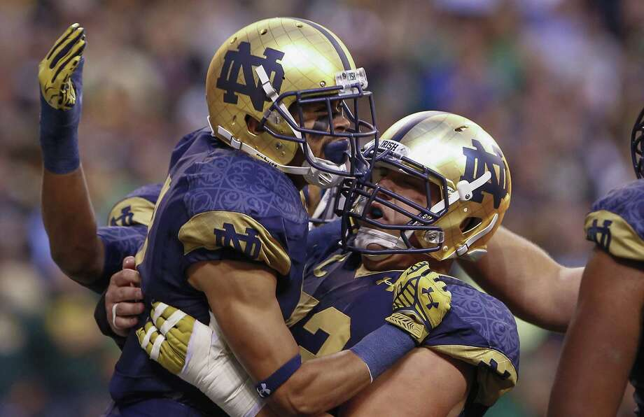 Wide receiver Will Fuller, left, and center Nick Martin can continue post-touchdown celebrations after the Notre Dame teammates both were selected by the Texans. Photo: Michael Hickey, Stringer / 2014 Getty Images