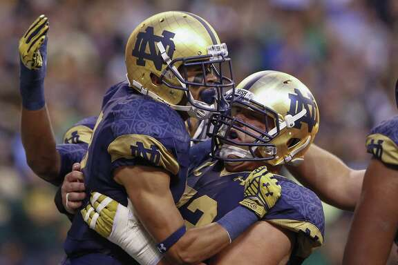 Wide receiver Will Fuller, left, and center Nick Martin can continue post-touchdown celebrations after the Notre Dame teammates both were selected by the Texans.