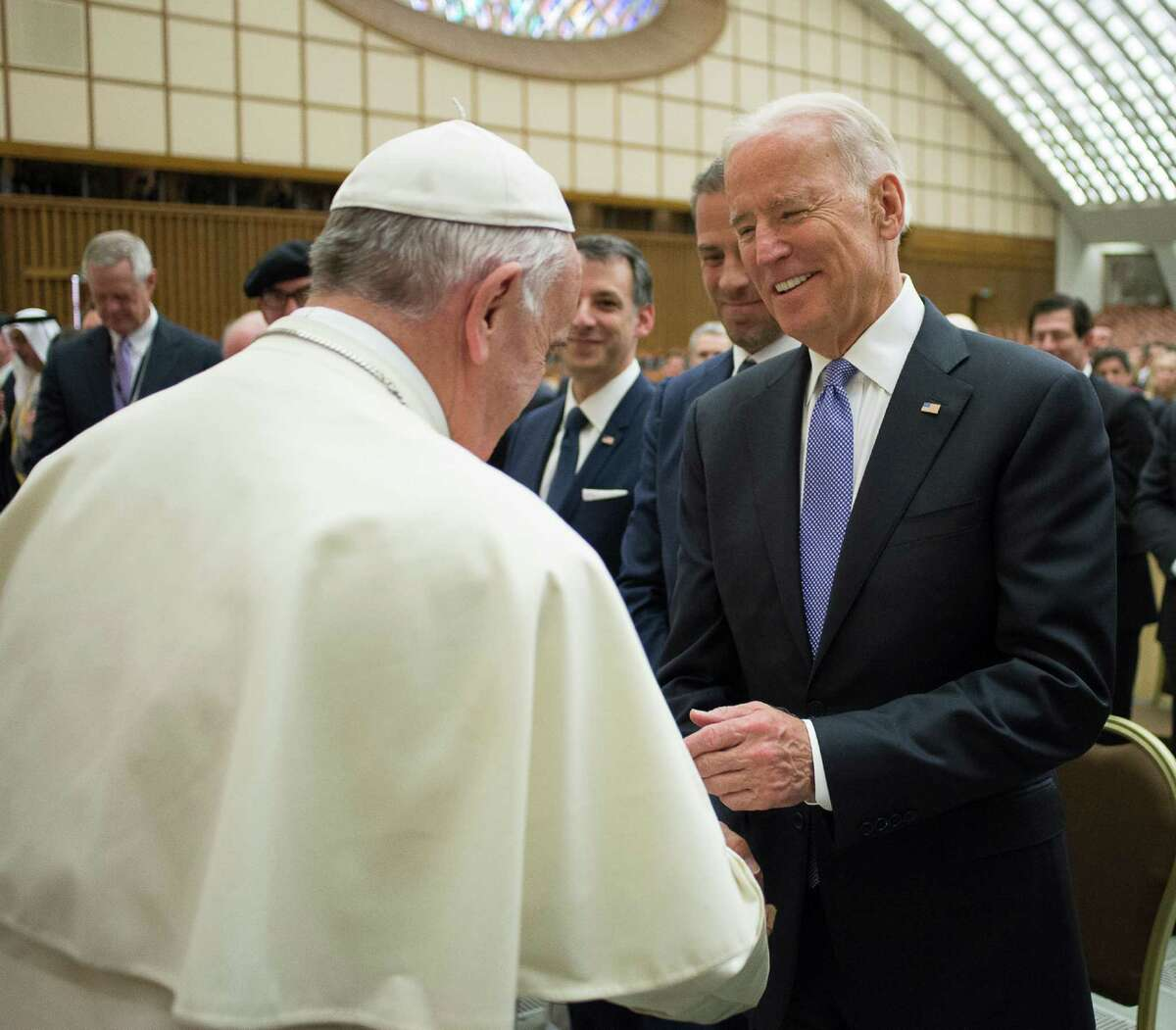 Pope Francis shakes hands with US vice president Joe Biden as he takes part at a congress on the progress of regenerative medicine and its cultural impact, being held in the Pope Paul VI hall at the Vatican, Friday, April 29, 2016. (L'Osservatore Romano/Pool photo via AP) ORG XMIT: OSS102