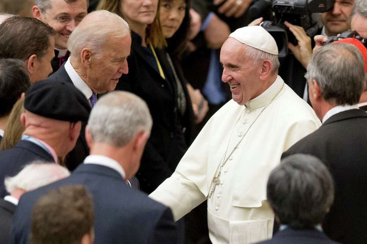 Pope Francis shakes hands with US vice president Joe Biden as he takes part at a congress on the progress of regenerative medicine and its cultural impact, being held in the Pope Paul VI hall at the Vatican, Friday, April 29, 2016. (AP Photo/Andrew Medichini) ORG XMIT: AJM112