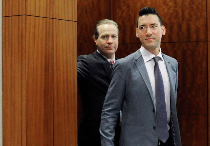 David Robert Daleiden, right, leaves a courtroom after a hearing Friday, April 29, 2016, in Houston. The anti-abortion activist is accused of record tampering for using a fake driver's license to conceal his identity while dealing with Planned Parenthood. He's also charged with misdemeanor attempting to buy human organs. (AP Photo/Pat Sullivan)