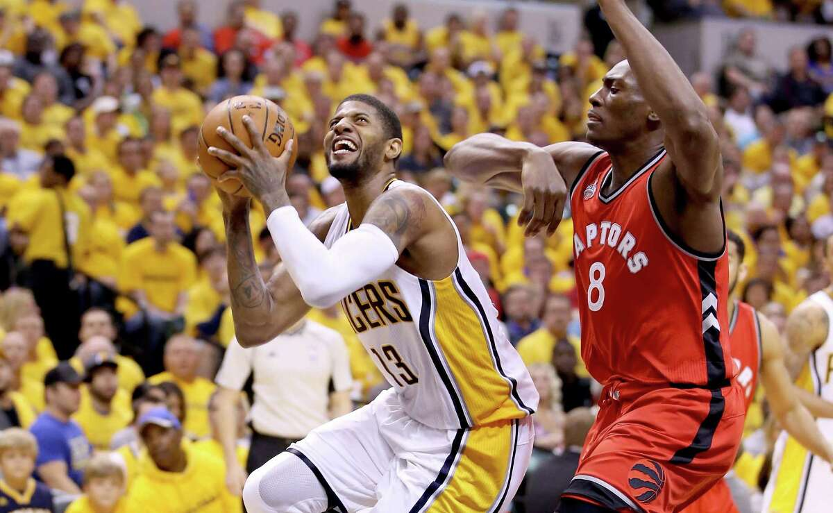 INDIANAPOLIS, IN - APRIL 29: Paul George #13 of the Indiana Pacers shoots the ball against the Toronto Raptors in game six of the 2016 NBA Playoffs Eastern Conference Quarterfinals on April 29, 2016 in Indianapolis, Indiana. NOTE TO USER: User expressly acknowledges and agrees that, by downloading and or using this photograph, User is consenting to the terms and conditions of the Getty Images License Agreement. (Photo by Andy Lyons/Getty Images) ORG XMIT: 629954057