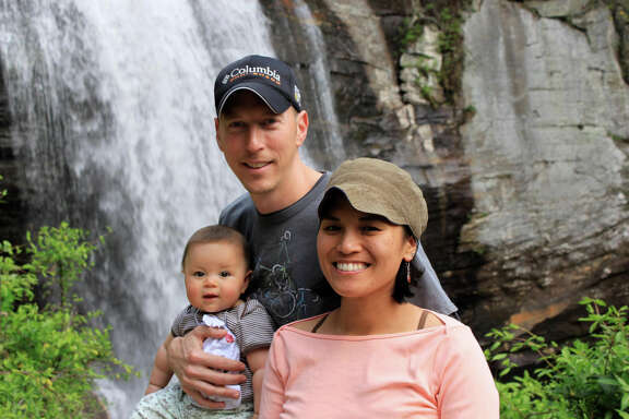 Jamie Gilpin, wife Joy Cadelina Gilpin and daughter Celeste. Inquiries are down at his bicycle tour business.